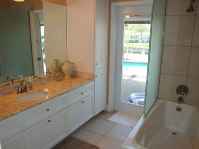 Main bath has double sinks & opens to the pool deck.