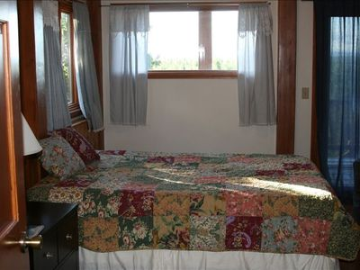 3rd Chalet bedroom with queen bed and direct access to large deck. Shares bath.