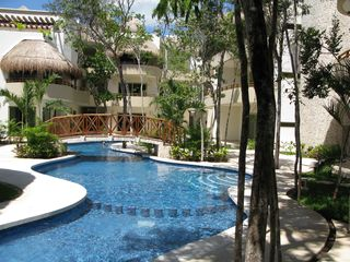 Tulum condo photo - Incredible pool flows through the trees.