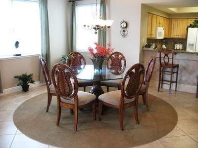 Nice Dining area sitting on area rug. Seats six