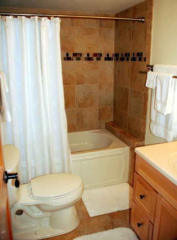 Beautiful tile in the master bathroom, complete with jetted tub and shower.