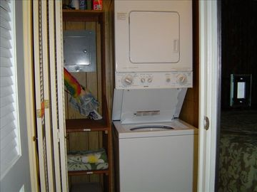 Our condo has its own stacked washer and dryer in hallway closet.