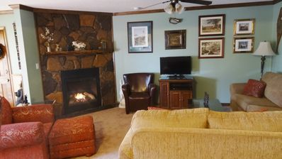 Cozy gas fireplace in lovely room, perfect for entertaining and relaxing.