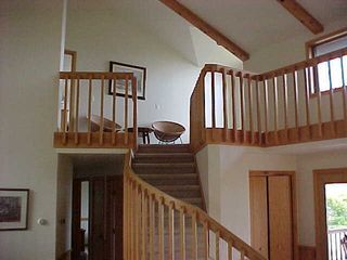Jacksonport house photo - Stairs to the Upper Level with Master Bedroom and semi-private sleeping on loft