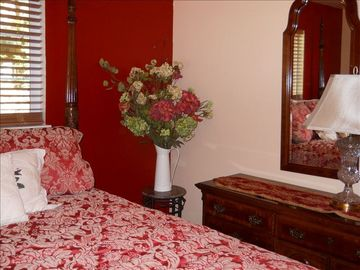 "The ""Red Room"" with romantic Queen Anne Rice Poster bed."