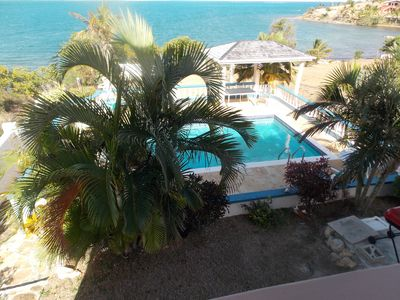 image for Antigua's most inviting oceanfront family villa, with panoramic views.