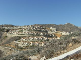 View of the Villas. Each level is carved out of a solid granite on the hillside - Cabo San Lucas villa vacation rental photo