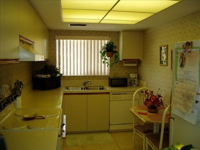 Large, fully-stocked kitchen with microwave, dishwasher, pots, pans, tv, more.