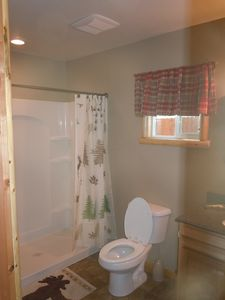 bathroom with new shower,toilet,flooring and vanity with granite counter top