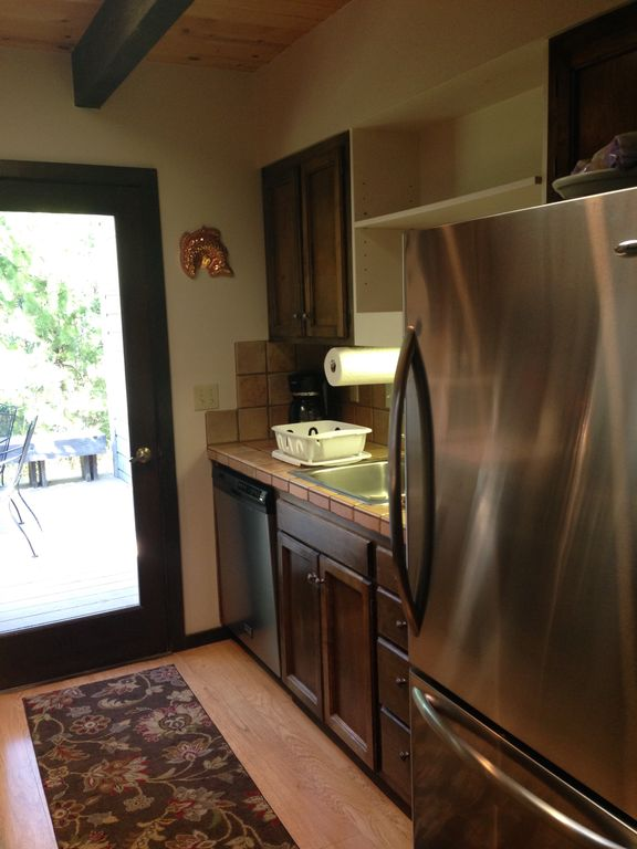 Charming updated family home steps away from vrbo for Updated galley kitchen photos