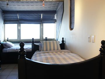 2nd floor bedroom with 180 degree panoramic view. Each bed has pull-out trundle.