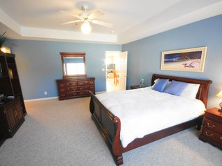 Lake Ozark condo photo - Queen Master Suite w/ Private Bath & Lots of Room! Overlooks Pool & Courts