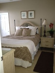 Master bedroom downstairs has a queen bed. Private balcony over looks Lake.