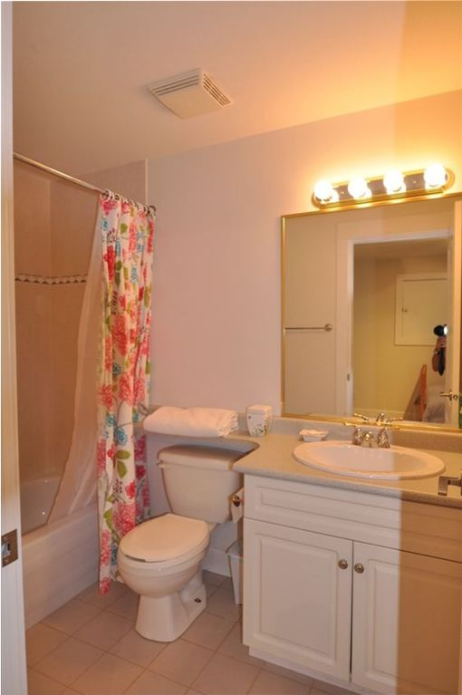 Bathroom. Arm in mirror not included.