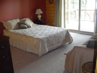 Cedar Lake cabin photo - Master bedroom opens to main floor deck and veiws the lake.