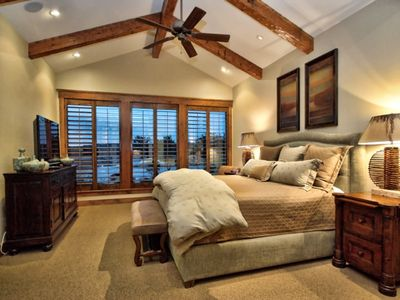 Beautiful Master Suite overlooks Lake Travis through large, open windows.