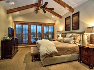Spicewood estate photo - Beautiful Master Suite overlooks Lake Travis through large, open windows.