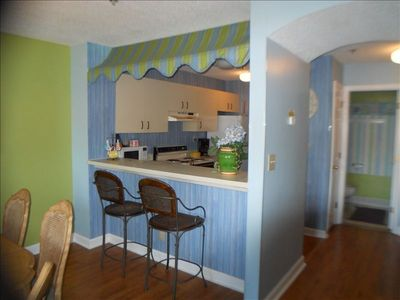 Convenient breakfast bar & view into kitchen. Full IN UNIT Laundry off Kitchen
