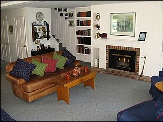 Vail townhome photo - Cozy Great Room with Gas Fireplace and Back Deck Access