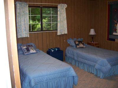 Harbor Springs cottage rental - 3rd bedroom with 2 single beds, large dresser, and full closet