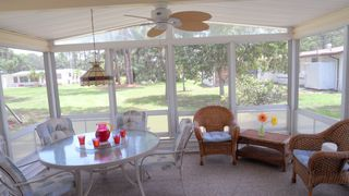 Englewood house photo - Enclosed screened in porch