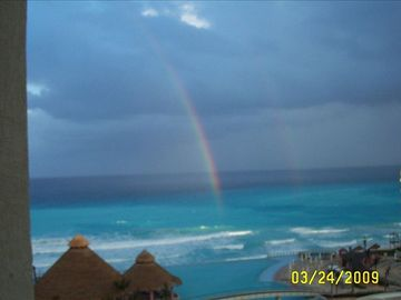 The beauty of a rainbow over the beach.