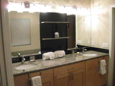 Master bath with granite counter, double vanity.