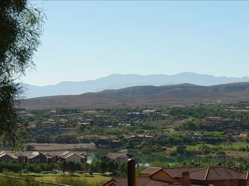 Henderson condo rental - View from the front patio. Lake Las Vegas below. Lights of Las Vegas at night!