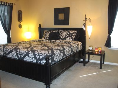 Master bedroom has reading lights and candles for both sides of the bed.