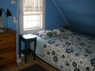 Dennis Village cottage photo - Blue bedroom, air-conditioned, with queen bed and view of Scargo Lake.