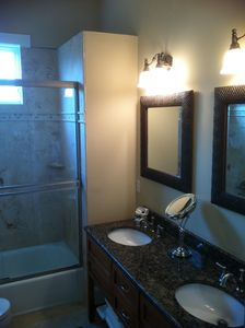 Rear Master Bath with dual sinks, walk in closet and bathtub/shower combination