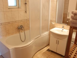 Ploce apartment photo - A large bathtub with shower to help unwind after a day of sightseeing