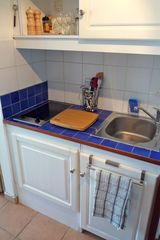 Marigot condo photo - Kitchenette with ceramic heater, chopping board, kitchen utensils complete.