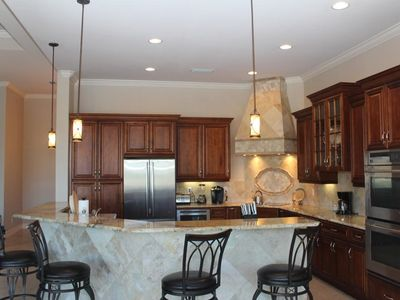 Kitchen with Cherry cabinetry, exotic granite & stainless Jenn-Air appliances