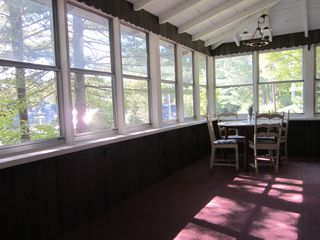 Jay Peak house photo - Play games or enjoy your meals on the large screened in porch with lake views.