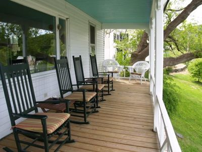 Large wrap-around porch for relaxing, dining and taking in the beautiful view