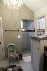 Northport cottage photo - Master Bathroom with Steuben crystal chandelier, dual headed shower, vessel sink