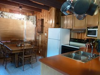 Flagstaff cabin photo - Eat in kitchen. Antique Oak Table with extra leaves for comfortable seating.