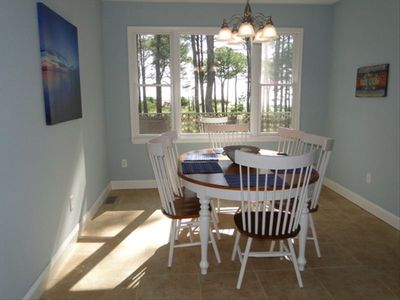 Enjoy bay views from the sunny dining room.