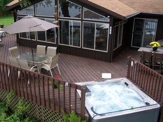 Wisconsin Dells house photo - Large Wrap Around Deck with Year Round Hot Tub & Gas BBQ Grill!