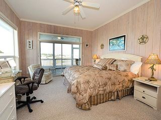 Master Bedroom w/doors to screen porch; 44'TV w/Blu-ray player. - Grayton Beach house vacation rental photo