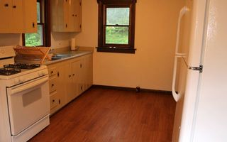 Bourne cottage photo - Kitchen with stove, microwave and Keurig Machine.