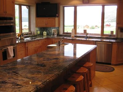 Gourmet Kitchen -- Cabinets and Granite Counters with Views of Hebgen Lake