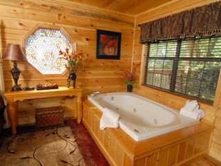 Pigeon Forge cabin photo - Master suite's bedside Jacuzzi tub for two.