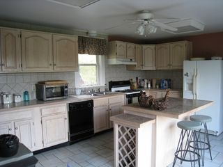 Roscoe farmhouse photo - Eat-in kitchen, island seats 6