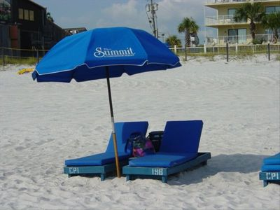Complimentary set of  Summit beach chairs, cushions, and umbrella set up daily.
