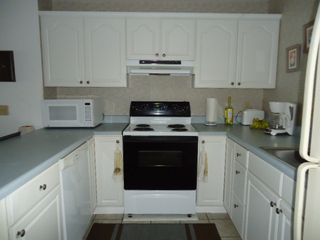 North Topsail Beach condo photo - Fully equipped kitchen with dishwasher, microwave, etc.