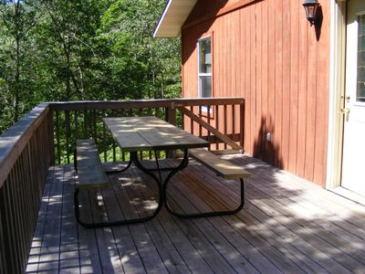Large Picnic Table on side of deck