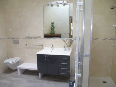 Modern tiled bathroom with shower.