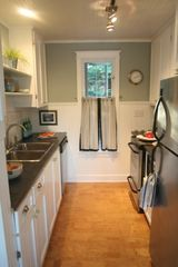 Stanley Bridge cottage photo - Complete galley kitchen with modern appliances.